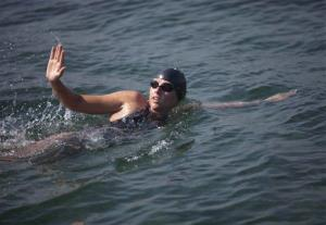 Australian swimmer Chloe McCardel waves to spectators as she begins her swim to Florida from the waters off Havana, Cuba, Wednesday, June 12, 2013.