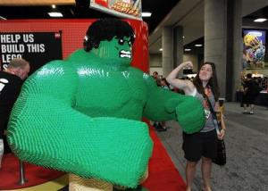 Abbey Stubblefield poses next to a LEGO Hulk figure in the exhibit hall on preview night at Comic-Con on at the San Diego Convention center Wednesday, July 11, 2012, in San Diego.