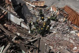 Rescue personnel work at the scene of a building collapse in downtown Philadelphia Wednesday June 5, 2013.