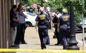 St. Louis police work the scene of the fatal shooting.
