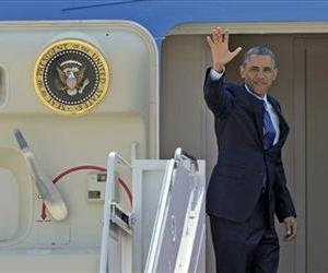 President Barack Obama waves from the top of the steps of Air Force One at Andrews Air Force Base, Md., June 12, 2013.