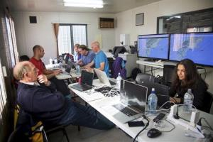 In this June 12, 2013 photo released by Google, Google's team at mission control monitors a balloon launch in Christchurch, New Zealand.