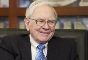 Warren Buffett smiles during a television interview.