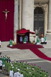 Pope Francis, in green under the canopy, celebrates a mass in St. Peter's Square, Sunday, June 16, 2013. The pontiff greeted hundreds of Harley riders and blessed their motorcycles prior to the mass.