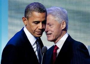 President Barack Obama steps to the microphone after being introduced by former President Bill Clinton.