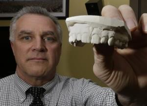 Dr. Frank Wright, a forensic dentist, studying evidence in a bite mark analysis, which he practices on a regular basis in between seeing patients, is photographed at his office in Cincinnati.