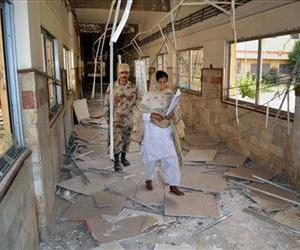 A Pakistani paramilitary soldier and a nurse walk through a damaged corridor caused by Saturday's bombing at the Bolan Medical complex in Quetta, Pakistan, Sunday, June 16, 2013.