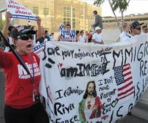 Hilda Canales, 40, joins hundreds of protestors in a May Day march through the streets of downtown Phoenix, May 1, 2013.