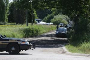 Law enforcement officials block the street to the scene in Oakland Township, Mich., Monday, June 17, 2013 where officials search for the remains of Teamsters union president Jimmy Hoffa.
