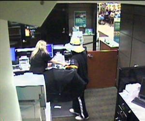 An image form a surveillance video released by the South Strabane Township Police shows a robbery Sunday, June 16, 2013, at the Citizens Bank inside the Giant Eagle at Strabane Square.