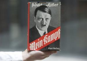 Adolf Hitler's infamous memoir Mein Kampf is presented during a news conference in Nuremberg, southern Germany, Tuesday, April 24, 2012. The German state of Bavaria says it's preparing for the expiry in 2015 of the copyright on Adolf Hitler's infamous memoir Mein Kampf by supporting the preparation of new editions...