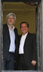 WikiLeaks founder Julian Assange, left, appears with Ecuador's Foreign Minister Ricardo Patino on the balcony of the Ecuadorian Embassy in London, Sunday, June 16, 2013.