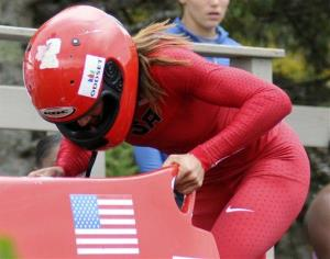 In this 2012 file photo, Lolo Jones competes in the U.S. women's bobsled push championships in Lake Placid.