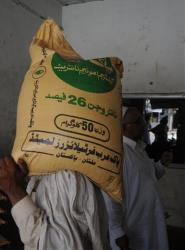 In this photo taken on Aug 25, 2011, a Pakistani worker carries a sack of fertilizer containing ammonium nitrate in Multan, Pakistan.