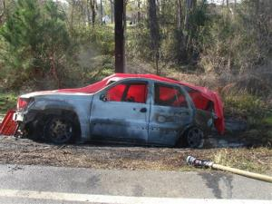 This 2012 photo shows the scene of a crash in Bainbridge, Ga., where a 4-year-old boy died in a fire when a Jeep Grand Cherokee was struck from the rear.