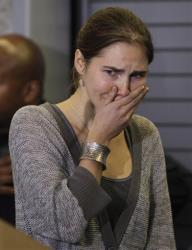 In this Oct. 4, 2011, file photo, Amanda Knox appears at a news conference in Seattle after being freed in Italy.