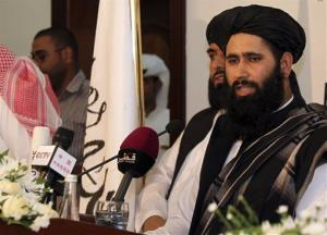 Muhammad Naeem, a representative of the Taliban, speaks during a press conference at the official opening of their office in Doha, Qatar, yesterday.