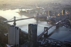 This May 10, 2013 file photo shows view of the Manhattan Bridge, left, and Brooklyn Bridge as seen from the 105th floor of One World Trade Center, in New York.