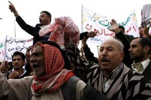 Hundrends of Iraqi protesters demonstrate against an election law they said reduced the number of seats in their province, Nineveh.