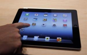In this March 7, 2012, file photo, an Apple iPad is on display during an Apple event in San Francisco.