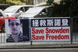 A banner supporting Edward Snowden is displayed at Central, Hong Kong's business district, Wednesday, June 19, 2013.