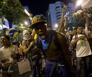Demonstrators shout slogans during an anti-government protest in Rio de Janeiro's sister city, Niteroi, Brazil, Wednesday evening, June 19, 2013.