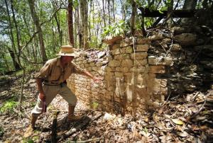 A worker shows the remains of a building in the newly found Mayan city of Chactun.
