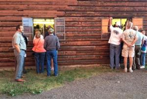 People attend a town meeting in South Fork, Colo., on Thursday. The town is now evacuated.