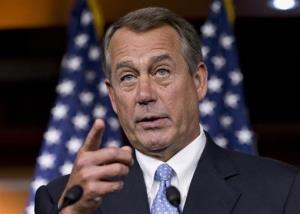 House Speaker John Boehner responds to reporters' questions on Capitol Hill.