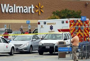 An ambulance sits in the parking lot of a Walmart in Greenville, N.C.