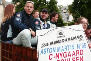 Danish Driver Allan Simonsen, left, is seen during a parade on the eve of the 90th 24-hour Le Mans endurance race.