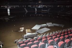 This photo provided by the Calgary Flames shows the inside of the Calgary Saddledome, which was flooded up to the 10th row, leaving the dressing rooms submerged.
