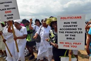 Jamaican churchgoers chant during an anti-gay rally in Kingston, Jamaica, Sunday, June 23, 2013.