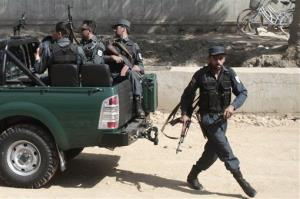 Afghan national security arrive near the entrance gate of the presidential palace in Kabul, Afghanistan, today.
