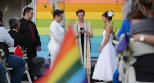Kimberly Kidwell and Katie Short get married at Equality House in Topeka, Kansas.
