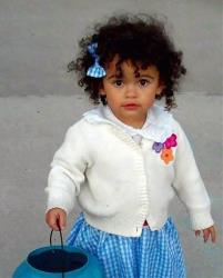This October 2011 photo provided by Melanie Capobianco shows her adoptive daughter Veronica trick-or-treating, in Charleston, SC.