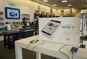 In this Tuesday, Feb. 26, 2013 file photo, Nook tablets are on display at a Barnes and Noble bookstore in Los Angeles.