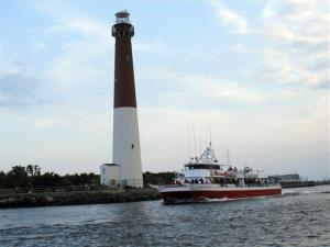 Two people were seriously injured when the wave slammed into Barnegat Light, New Jersey.