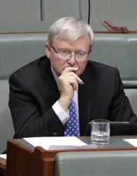 Former Australian Prime Minister Kevin Rudd sits in parliament during question time in Canberra, Australia today.