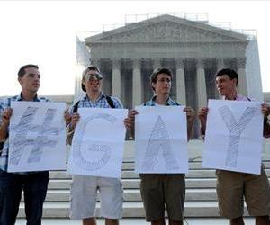 Activists wait for a ruling on same sex marriage at the Supreme Court in Washington, June 26, 2013.