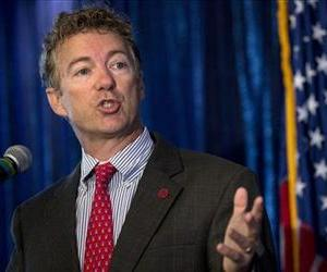 Sen. Rand Paul, R-Ky. gestures as he speaks in Washington, Wednesday, June 12, 2013.