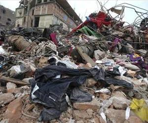 In this Saturday, May 4, 2013 file photo, pairs of brand new denim jeans are strewn over rubble from collapsed Rana Plaza garment factory building in Savar, near Dhaka, Bangladesh.