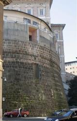 This file photo shows a building, left, which hosts the Vatican bank, inside the Vatican.