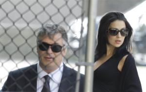Alec Baldwin, left, and his wife Hilaria Thomas arrive at Cathedral Church of Saint John the Divine before funeral services for actor James Gandolfini, Thursday, June 27, 2013, in New York.