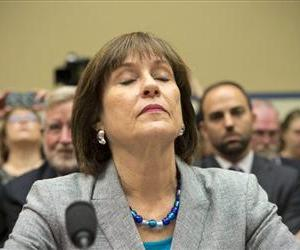 Lois Lerner, head of the IRS unit that decides whether to grant tax-exempt status to groups, listens on Capitol Hill, May 22, 2013, during a House Oversight and Government Reform Committee hearing.