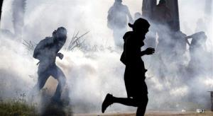 Protesters run from tear gas in Fortaleza, Brazil.