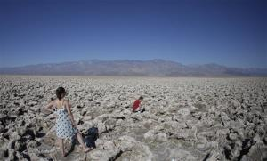 Eric Varone, right, takes a picture as Floriane Golay, of Switzerland watches, in Death Valley National Park, June 28, 2013.