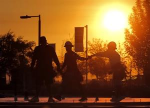 Construction workers gather at a new home site at sunrise to beat daytime high temperatures, Thursday, June 27, 2013 in Queen Creek, Ariz.
