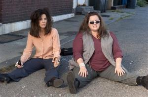 Sandra Bullock, left, and Melissa McCarthy in a scene from 'The Heat.'