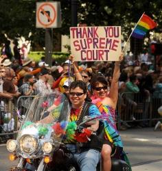 Participants ride up Market Street during San Francisco's 43rd annual Gay Pride parade Sunday, June 30, 2013.